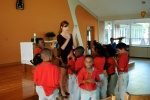 Elle singing with 2nd graders before their reading tutoring